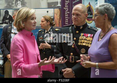 Commandant of the Marine Corps, Gen. Robert B. Neller, and his wife, D'Arcy Neller, right, speak to Mary C. Murphy, during a sunset parade reception at the Women in Military Service for America Memorial, Arlington, Va., Aug. 9, 2016. Sunset parades are held as a means of honoring senior officials, distinguished citizens and supporters of the Marine Corps. (U.S. Marine Corps photo by Cpl. Christian Varney) - Stock Photo