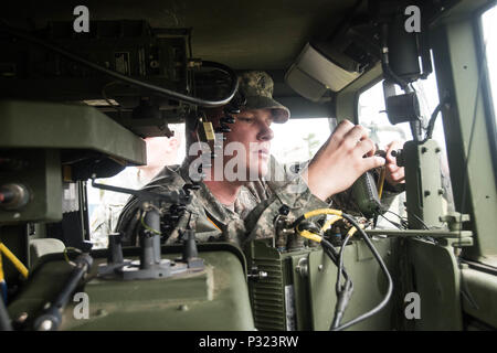 A member of South Carolina Army National Guard's 263rd Army Air and Missile Defense Command prepares his Avenger Air Defense System during the Vigilant Shield Air Defence Artillery Field Training Exercise at 22 Wing North Bay on August 14, 2016. (Canadian Armed Forces photo by Cpl. Joseph Morin) - Stock Photo