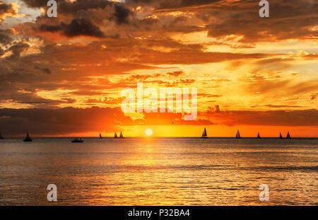 Sunset in Honolulu as viewed from Waikiki beach - Stock Photo