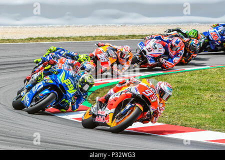 MARC MARQUEZ (93) of Spain, ANDREA IANNONE (29) of Italy, JORGE LORENZO (99) of Spain and ANDREA DOVIZIOSO (04) of Italy during the MotoGP race of the race of the Catalunya Grand Prix at Circuit de Barcelona racetrack in Montmelo, near Barcelona on June 17, 2018 (Photo: Alvaro Sanchez) - Stock Photo