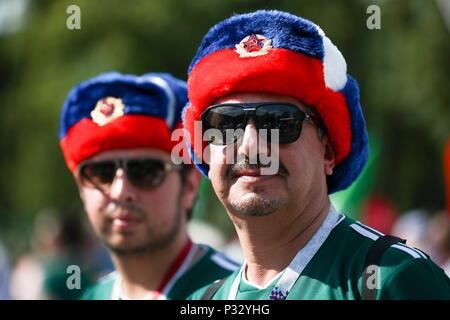 Moscow, Russia. 17th June, 2018 Mexican fans wearing ushanka hats in the colours of the Russian national flag seen ahead of the 2018 FIFA World Cup Group F football match between Germany and Mexico at Luzhniki Stadium. Valery Sharifulin/TASS Credit: ITAR-TASS News Agency/Alamy Live News - Stock Photo