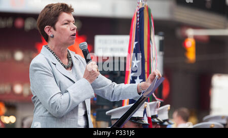 Loree Sutton, Commissioner of the New York City Department of Veterans' Services and retired U.S. Army brigadier general, speaks during a ceremony at Times Square, Aug. 29, 2016. Marines, both active and reserve, celebrated the 100th anniversary of the Marine Forces Reserve alongside Marine veterans, new recruits, and members of the New York Police Department and the Fire Department of New York. - Stock Photo