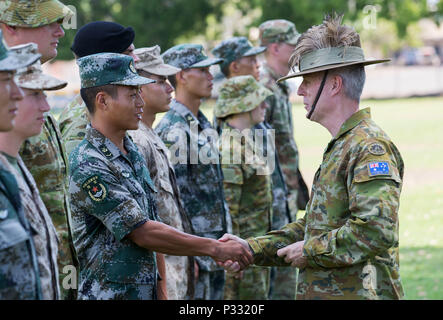 Australian Army officer Brigadier Damian Cantwell, AM, Deputy Commander 2nd Division, shakes hands with a soldier from the Chinese People's Liberation Army during the Exercise Kowari opening ceremony at Larrakeyah Barracks in Darwin, Northern Territory, on 26 August 2016. Kowari is an Australian army-hosted survival skills exercise designed to increase defense cooperation between forces from the U.S., Australia and China. (Australian Defence Force photo by Cpl. Jake Sims) - Stock Photo
