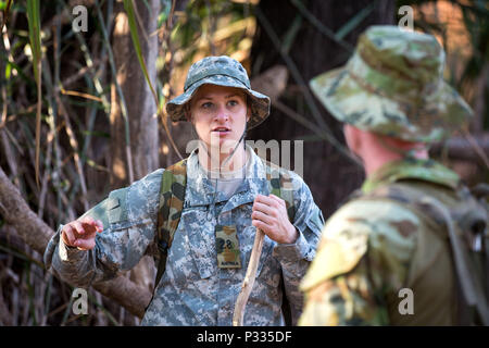 United States 2nd Lt. Shelby Blad talks with an Australian soldier during the training phase of Exercise Kowari, being held in the Daly River region of the Northern Territory, on 29 August 2016. Kowari is an Australian army-hosted survival skills exercise designed to increase defense cooperation between forces from the U.S., Australia and China. (Australian Defence Force photo by Cpl. Jake Sims) - Stock Photo