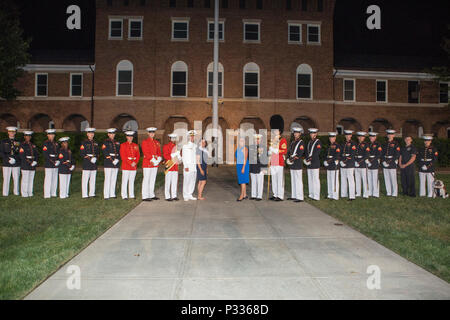 Chief of Naval Operations Adm. John M. Richardson and his wife, Dana Richardson, center left, pose for a photo with the Commandant of the Marine Corps Gen. Robert B. Neller, his wife, D'arcy Neller, and Marines from Marine Barracks Washington after the evening parade at Marine Barracks Washington, Washington D.C., Aug. 19, 2016. Evening parades are held as a means of honoring senior officials, distinguished citizens and supporters of the Marine Corps. (U.S. Marine Corps photo by Lance Cpl. Stephon L. McRae) - Stock Photo