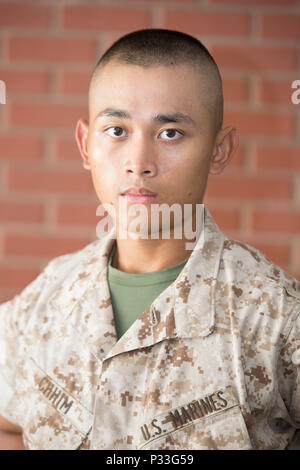 Pvt. Pich Chimm, Platoon 3068, India Company, 3rd Recruit Training Battalion, earned U.S. citizenship Sept. 1, 2016, on Parris Island, S.C. Before earning citizenship, applicants must demonstrate knowledge of the English language and American government, show good moral character and take the Oath of Allegiance to the U.S. Constitution. Chimm, from Stafford, Va., originally from Cambodia, is scheduled to graduate Sept. 1, 2016. (Photo by Cpl. Vanessa Austin) - Stock Photo