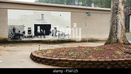an historical document of Wehaywood Feed and Trade Stable art mural in the Mount Gilead, North Carolina circa 2018 at Main Street by unknown artist - Stock Photo