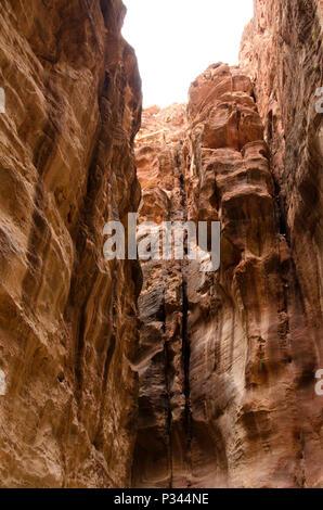 Tall narrow Siq canyon entrance to Petra, Jordan, Middle East - Stock Photo