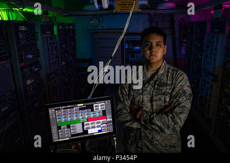 Airman 1st Class Kevin Plunkett, a radio frequency transmissions systems technician with the Hawaii Air National Guard's 169th Air Defense Squadron, stands in the radar equipment room located on Mt. Ka'ala Air Force station (AFS), Aug. 12, 2016, Oahu, Hawaii. Mt. Ka'ala AFS sits atop the highest point on the island of Oahu and houses the 169th ADS's radar equipment, which is used to monitor the airspace around the Hawaiian Islands. (U.S. Air Force photo by Tech. Sgt. Brandon Shapiro) - Stock Photo