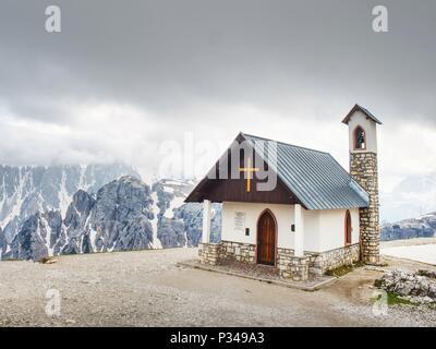 Tre Cime  tour. Mountain chapel near Tre Cime di Lavaredo in Dolomites Alps Italy - Stock Photo
