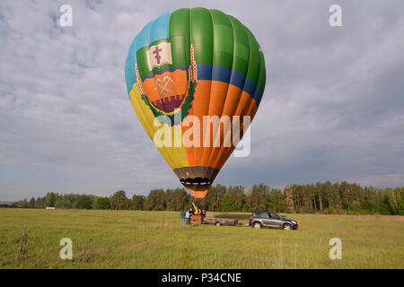 "Hot-air balloon getting ready for launching, trailer with equipment is near it. Festival of balloons ""Pereiaslav-2018"". May 6,2018. Pereiaslav,Ukraine - Stock Photo"