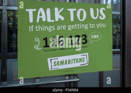 Samaritans help sign on the platform of St.Albans city station, Hertfordshire, England, U.K. - Stock Photo