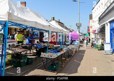 Busy Honiton High Street on a sunny summers day, East Devon England UK - Stock Photo