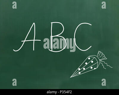 The letters ABC handwritten with chalk on a green chalkboard. - Stock Photo