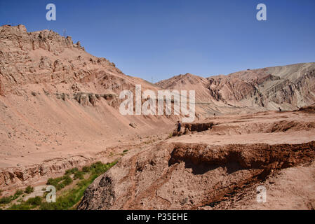 Spectrum of colors in the Flaming Mountains, Turpan, Xinjiang, China - Stock Photo