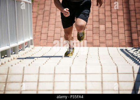 young asian adult male athlete using steps to train speed and strength. - Stock Photo