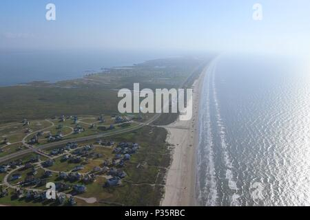 Aerial image of the Texas Gulf Coast, Galveston Island, USA. Haze due to warm weather conditions. Ocean, Gulf of Mexico, beach, real estate and travel - Stock Photo