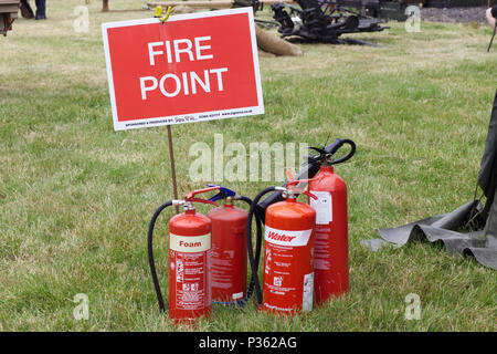 different types of fire extinguishers on show - Stock Photo