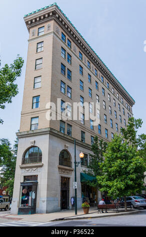 ASHEVILLE, NC, USA-10 JUNE 18:  The 1926 flatiron building, a retail and office building at Battery Park and Wall Streets. - Stock Photo
