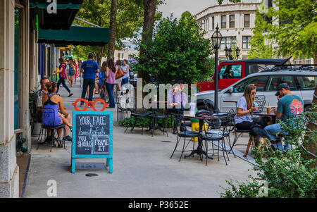 ASHEVILLE, NC, USA-10 JUNE 18:  Dining and socializing on a sunny Sunday on Battery Park Ave. - Stock Photo