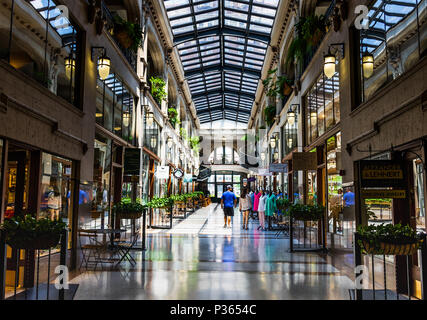 ASHEVILLE, NC, USA-10 JUNE 18:  A hallway inside the Grove Arcade, featuring a variety of small shops. - Stock Photo