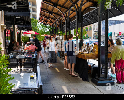 ASHEVILLE, NC, USA-10 JUNE 18:  A covered outside sales and dining area at the Grove Arcade, where local craftsmen display their wares. - Stock Photo