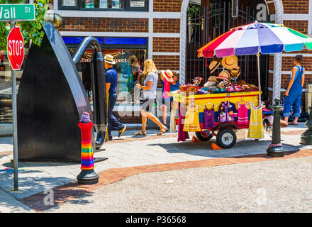 ASHEVILLE, NC, USA-10 JUNE 18:  A street vendor offers hats, and summer tops on a sunny, summer day. - Stock Photo