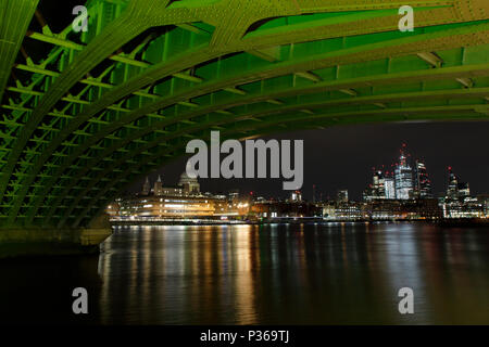 The city of London including Saint Pauls Cathedral from under Blackfriars Bridge, light-painted green with a powerful lamp - Stock Photo