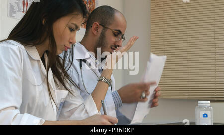Young nurse and male doctor having an argument in the office - Stock Photo