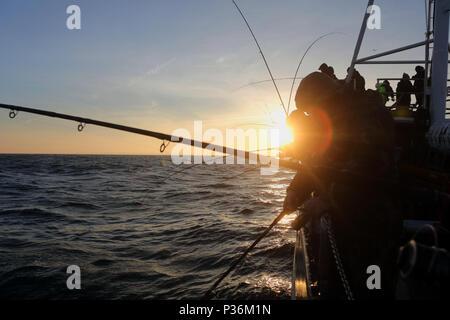 Wismar, Germany, men in deep-sea fishing on the Baltic Sea - Stock Photo