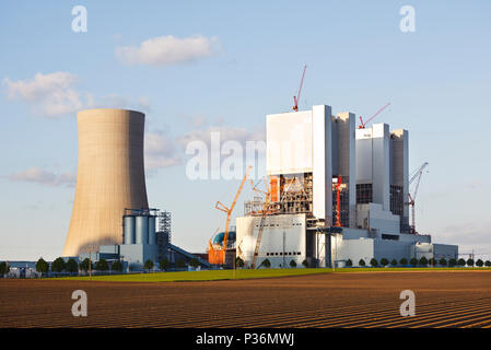Construction site of a new brown coal power plant in evening light. - Stock Photo