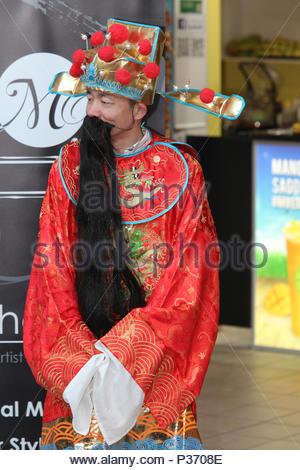 Markham, Ontario, Canada.  February 2015 --- A man dressed as Cai Shen, the Chinese God of Wealth issues in the Chinese Lunar New Year of the Sheep .  - Stock Photo