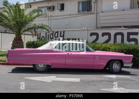Pink Cadillac car outside a Las Vegas wedding chapel, Nevada, usa - Stock Photo