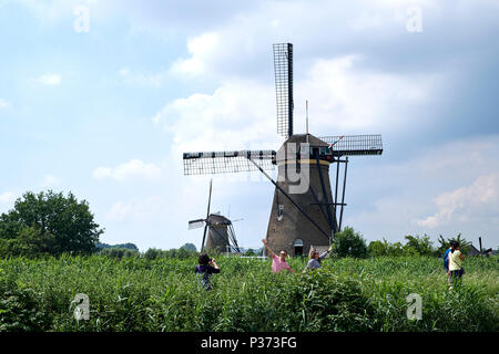 Kinderdijk in the province South Holland, Netherlands with windmills which have been used to drain the polder. Kinderdijk is UNESCO World heritage. - Stock Photo