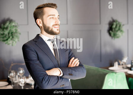 Cheerful ambitious restaurant owner - Stock Photo
