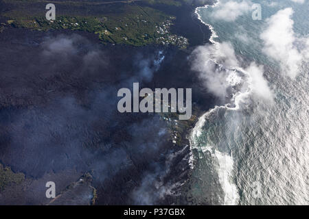 Aerial view of lava flows from the eruption of Kilauea volcano in Hawaii flowing into the sea near Kapoho, May 2018 - Stock Photo