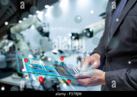 iot internet or intelligence of things in industrial concept, business or engineer use augmented mixed virtual reality to control monitor robot with a - Stock Photo