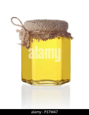 Glass jar of sweet honey isolated on white background - Stock Photo