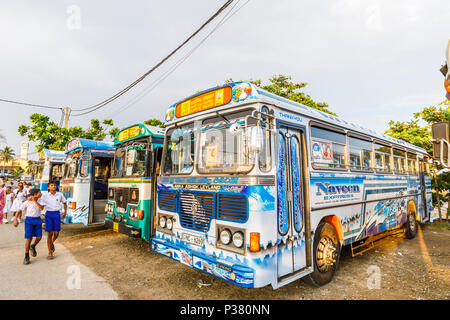 Colourful parked Lanka Ashok Leyland coaches used to take local schoolchildren on excursions to Galle Fort, Galle, Southern Province, Sri Lanka - Stock Photo