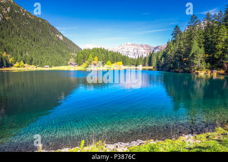Arnisee lake with Swiss Alps. Arnisee is a reservoir in the Canton of Uri, Switzerland. - Stock Photo