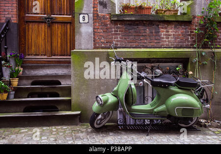 just take a picture of this beautifull green scooter fit with the background...love to watch - Stock Photo
