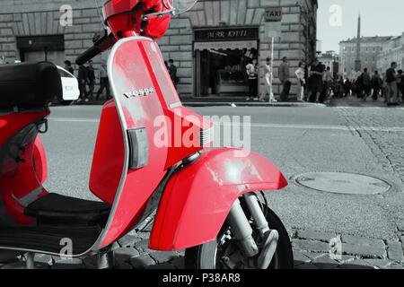 red scooter on the bright afternoon just make my eye straight to the camera to capture this beautifull models - Stock Photo