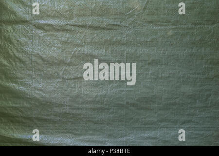 Full frame background of a wrinkled green tarp texture - Stock Photo