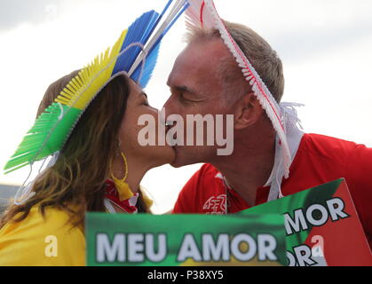 Rostov On Don, Russia. 17th June, 2018. ROSTOV-ON-DON, RUSSIA - JUNE 17, 2018: Brazilian football fans kiss before a First Stage Group E football match between Brazil and Switzerland at Rostov Arena at FIFA World Cup Russia 2018. Anton Novoderezhkin/TASS Credit: ITAR-TASS News Agency/Alamy Live News - Stock Photo