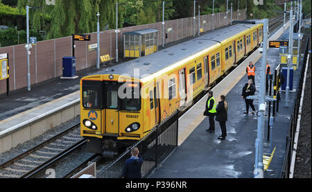 Maghull, UK. 18th June, 2018. First train leaves new station, Maghull, UK  The first passenger train to call at the newly built Maghull North station on Merseyside departs for Liverpool central at 05.59 hrs on the day the station opened.  Colin Wareing/Alamy Live News - Stock Photo