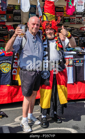 Berlin, Germany.. 17th June 2018. World Cup Football 2018.  Fans gather to watch the matches on giant screens placed along the Strasse on 17th June. The viewing area stretches for nearly two kilometres and the gigantic fan fest is known as the Fanmeile. Credit: Eden Breitz/Alamy Live News - Stock Photo