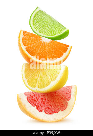 Isolated citrus slices. Pieces of grapefruit, orange, lemon and lime fruits on top of each other isolated on white background with clipping path - Stock Photo