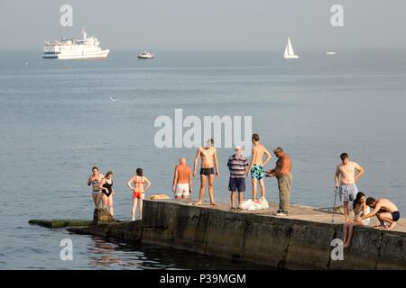 Odessa, Ukraine, bath houses on a pier on the Black Sea - Stock Photo