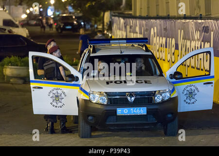 Odessa, Ukraine, riot police patrol in the evening in the city center - Stock Photo