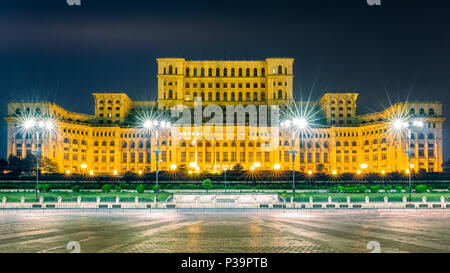 The public building of the Palace of the Parliament, by night, in Bucharest, Romania - Stock Photo